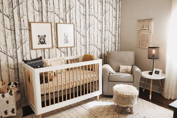 Contemporary, woodland-themed nursery with soft accents
