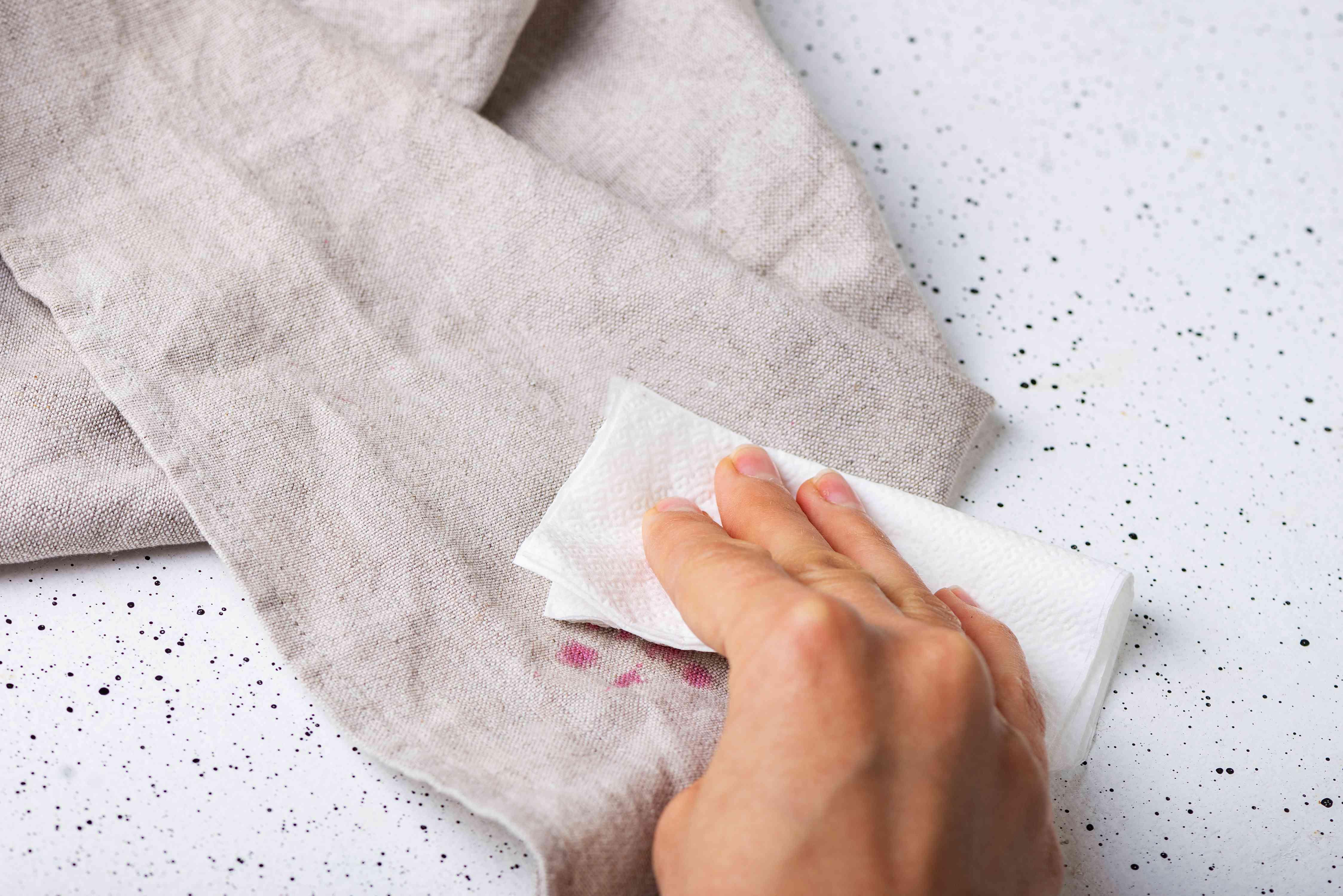 Blot linen cranberry stain