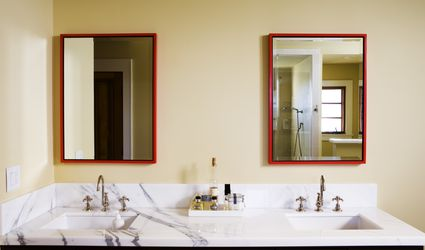 A contemporary master bathroom with two sinks