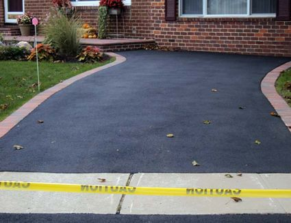 Is a tar and chip driveway right for your home learn how asphalt paving can give you a new driveway on the cheap solutioingenieria Image collections