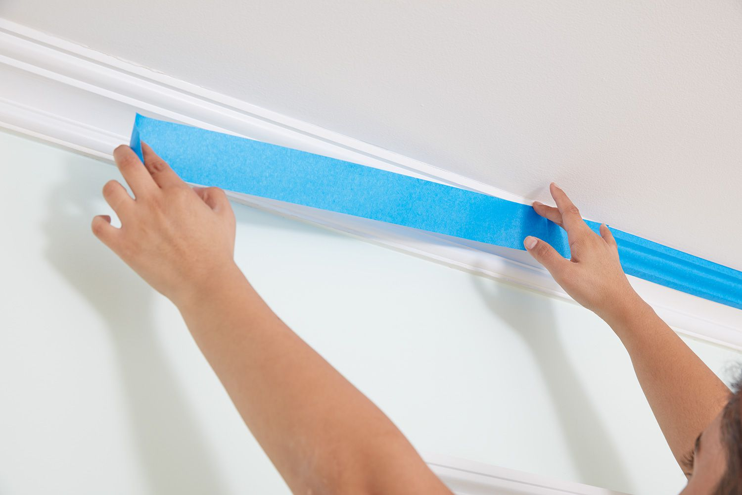 Protect surfaces and ceiling trim before painting ceiling