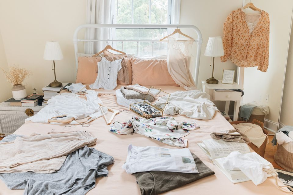many items on a bed