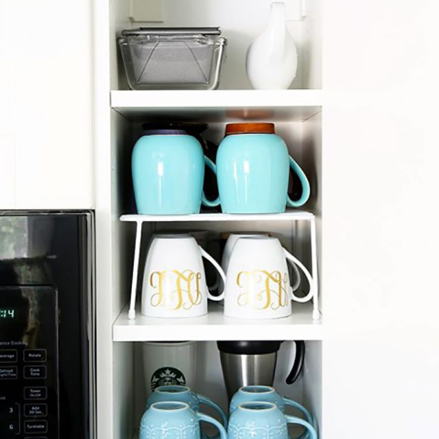 Mugs organized in a kitchen cabinet