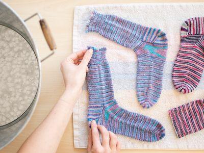 Wool socks laid on cloth towel to air dry
