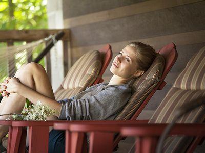 woman sitting alone on porch