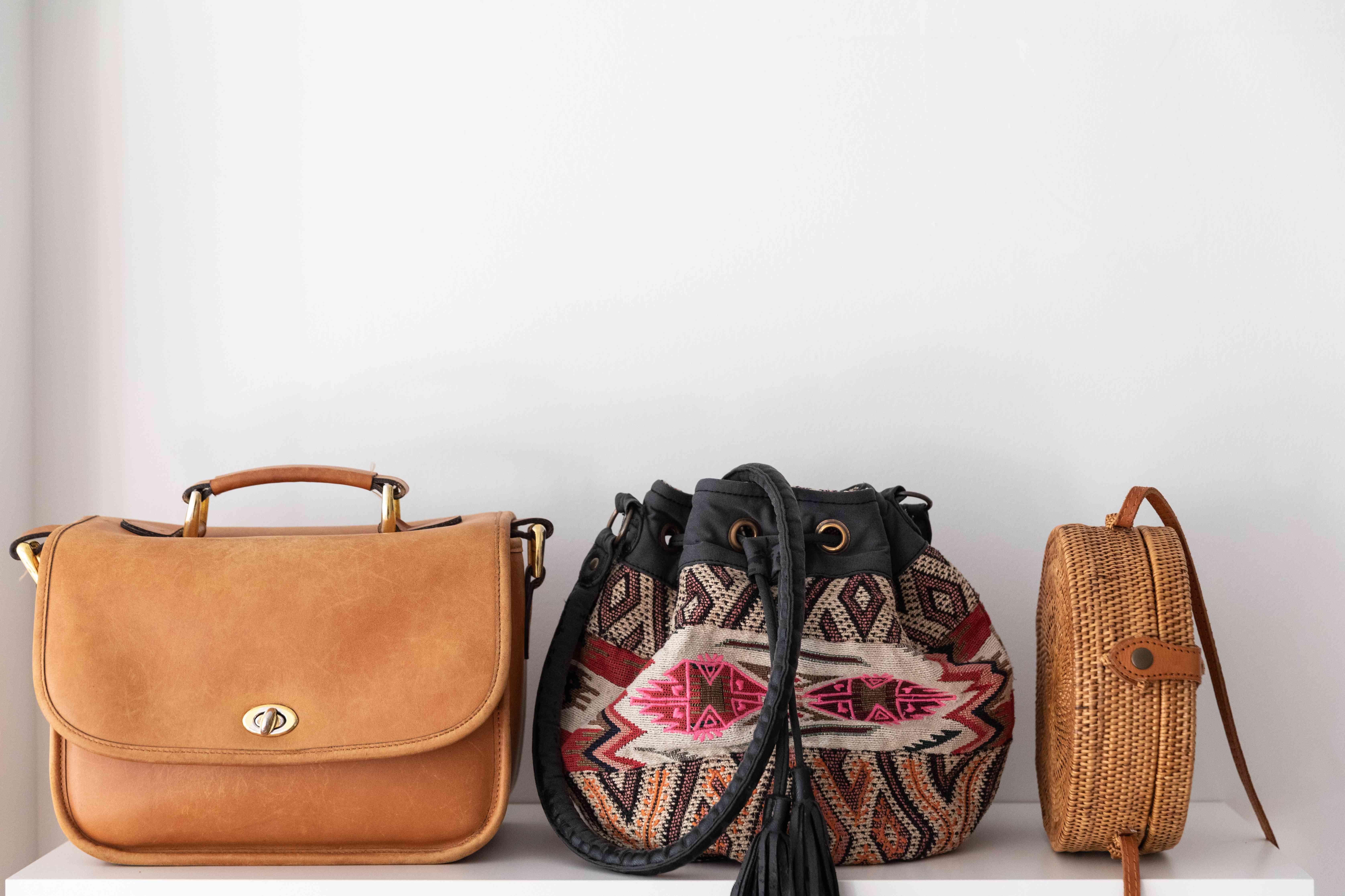 wall shelf holding handbags