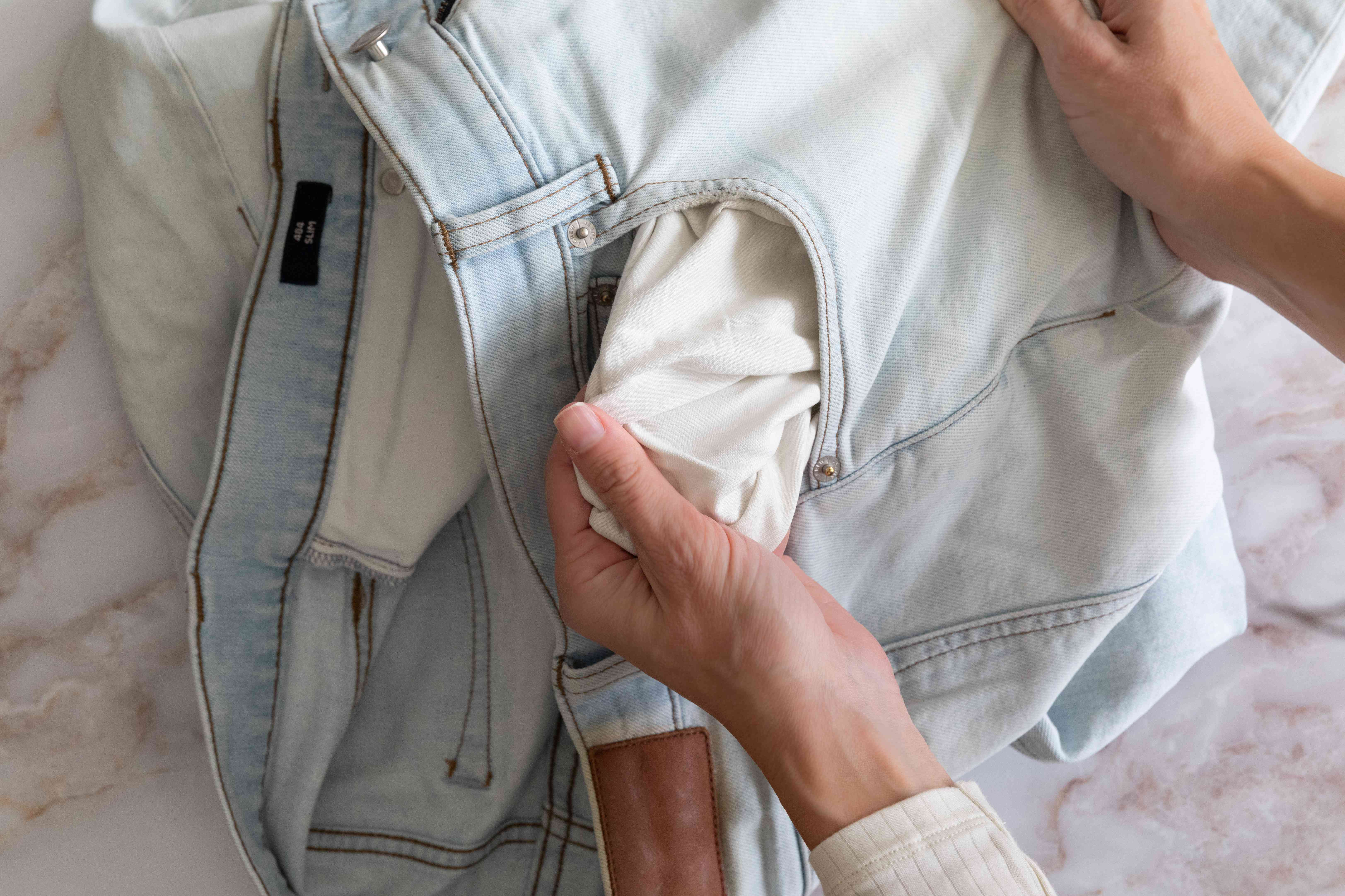 Denim pants pockets checked for loose items before washing