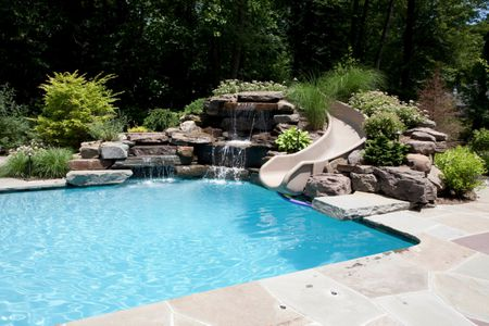 Backyard Pool Designs With Slides For Dive And Slide Family Pool Designs 50 Beautiful Swimming Pool Designs