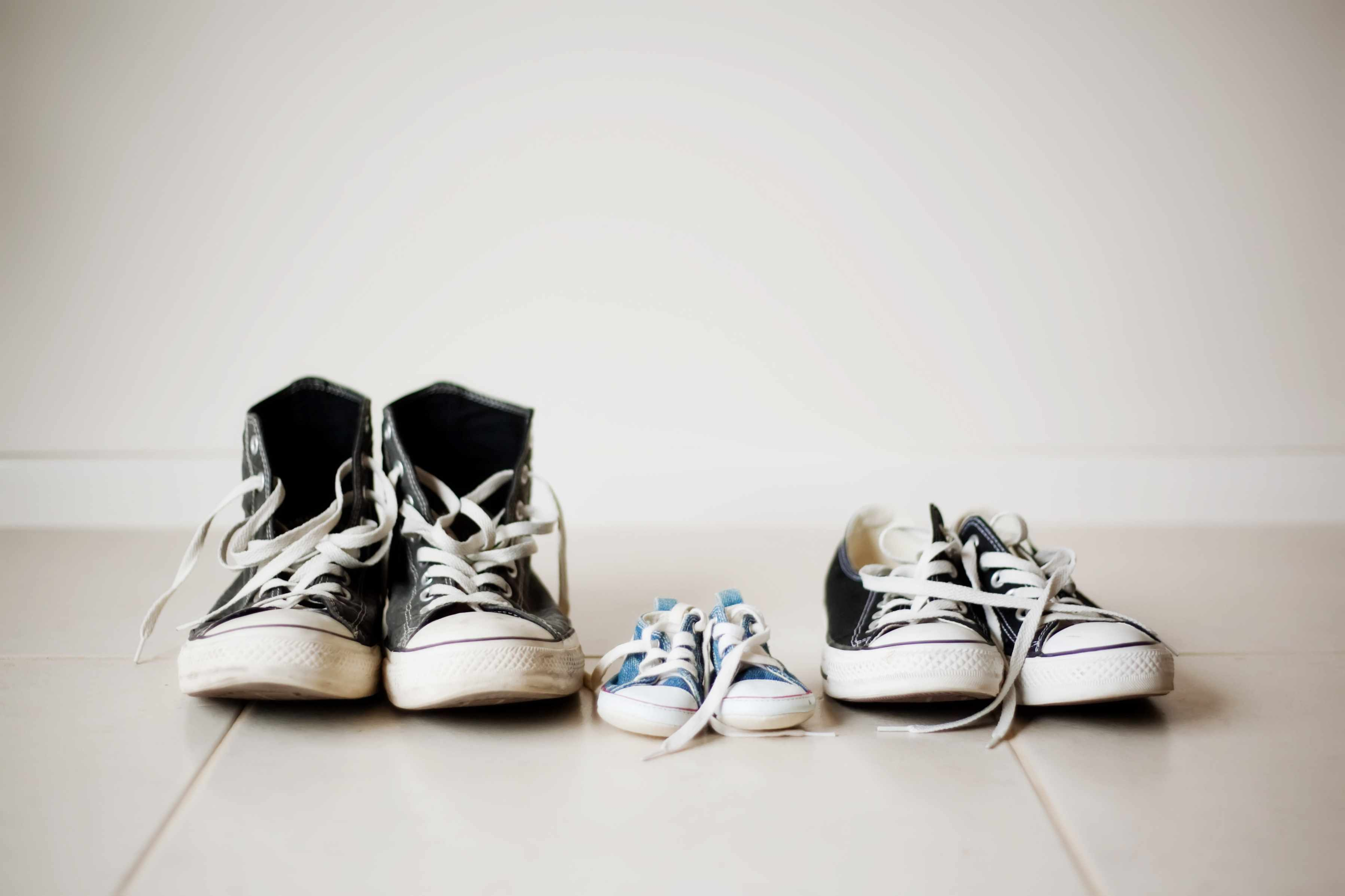 row of three pairs of shoes in varying sizes