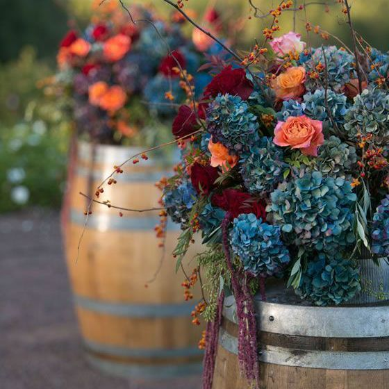 Barrels with flowers on top