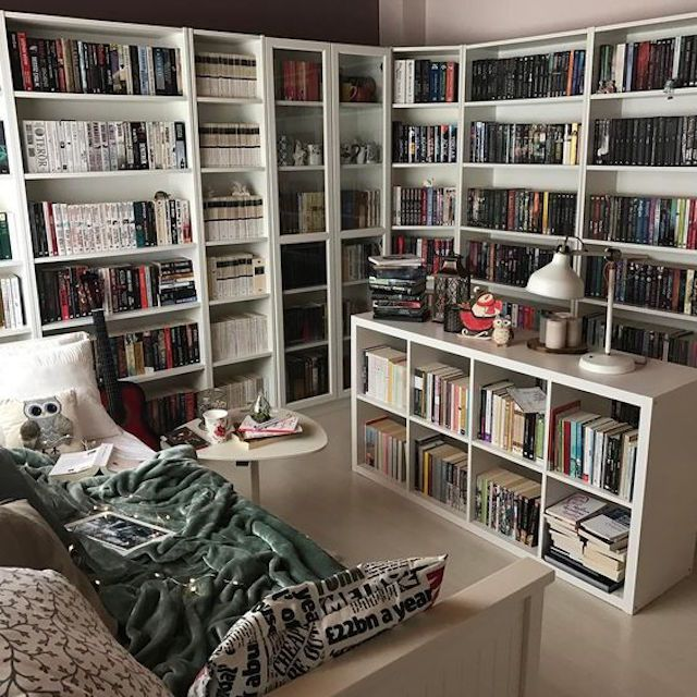 Massive wrap around home library with seating area