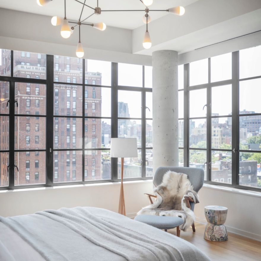 neutral bedroom with industrial modern accents and cool tones
