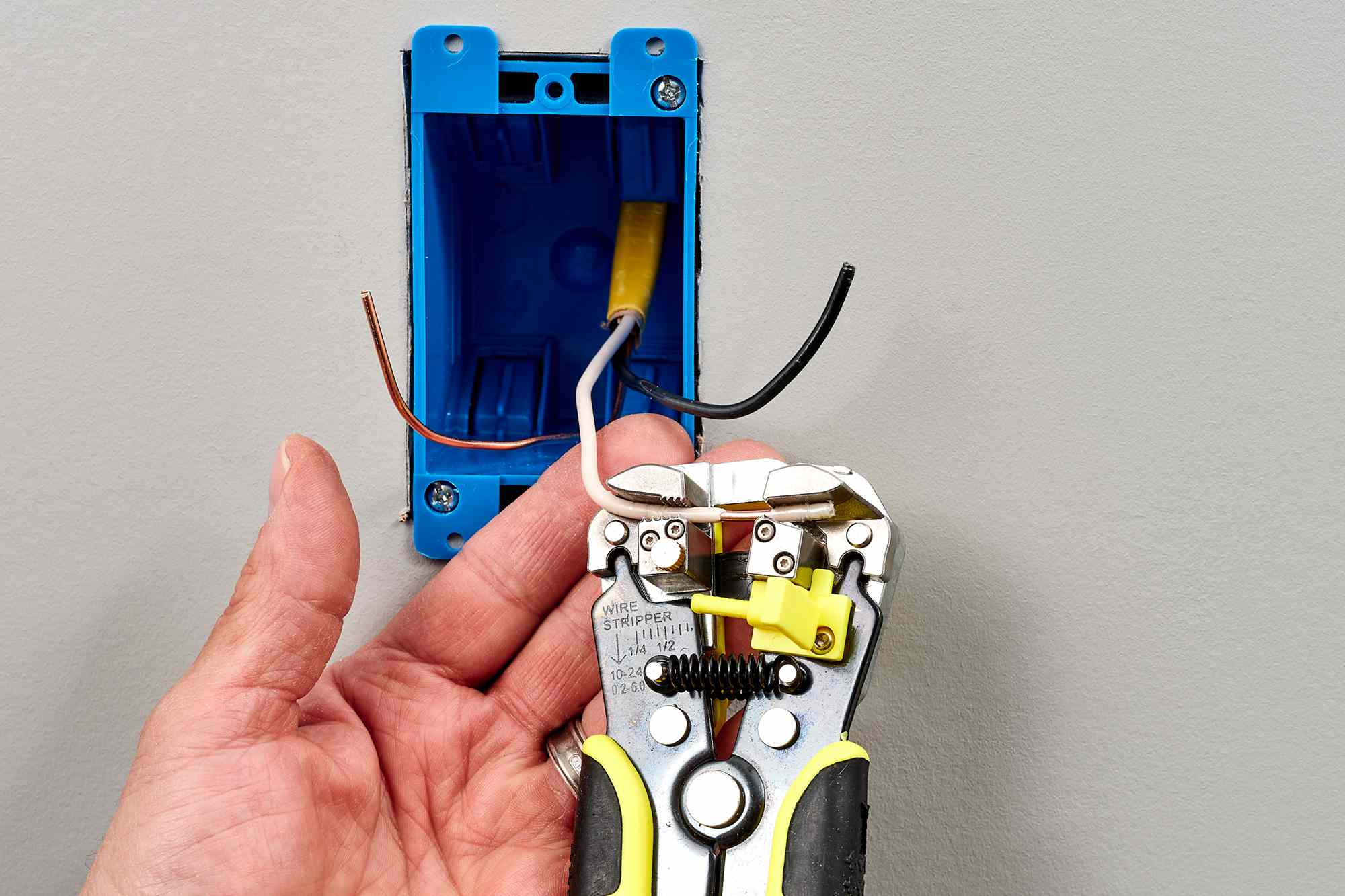 Wire strippers stripping insulation from wires