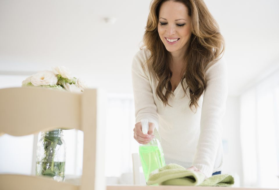 USA, New Jersey, Jersey City, Woman cleaning at home