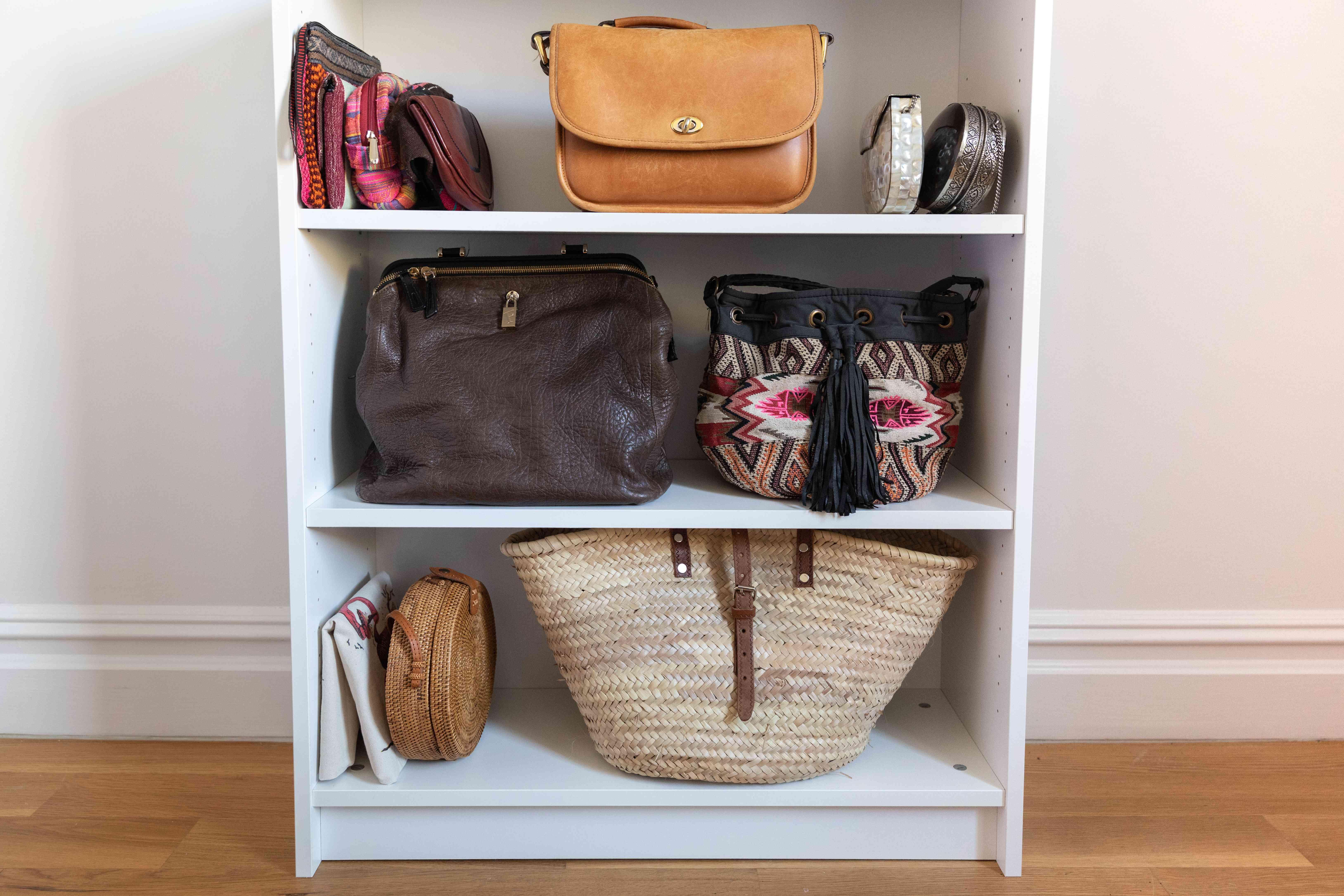 bookcase holding handbags