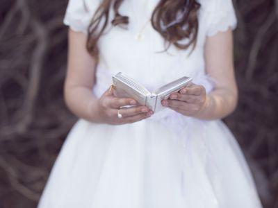 Little girl taking communion