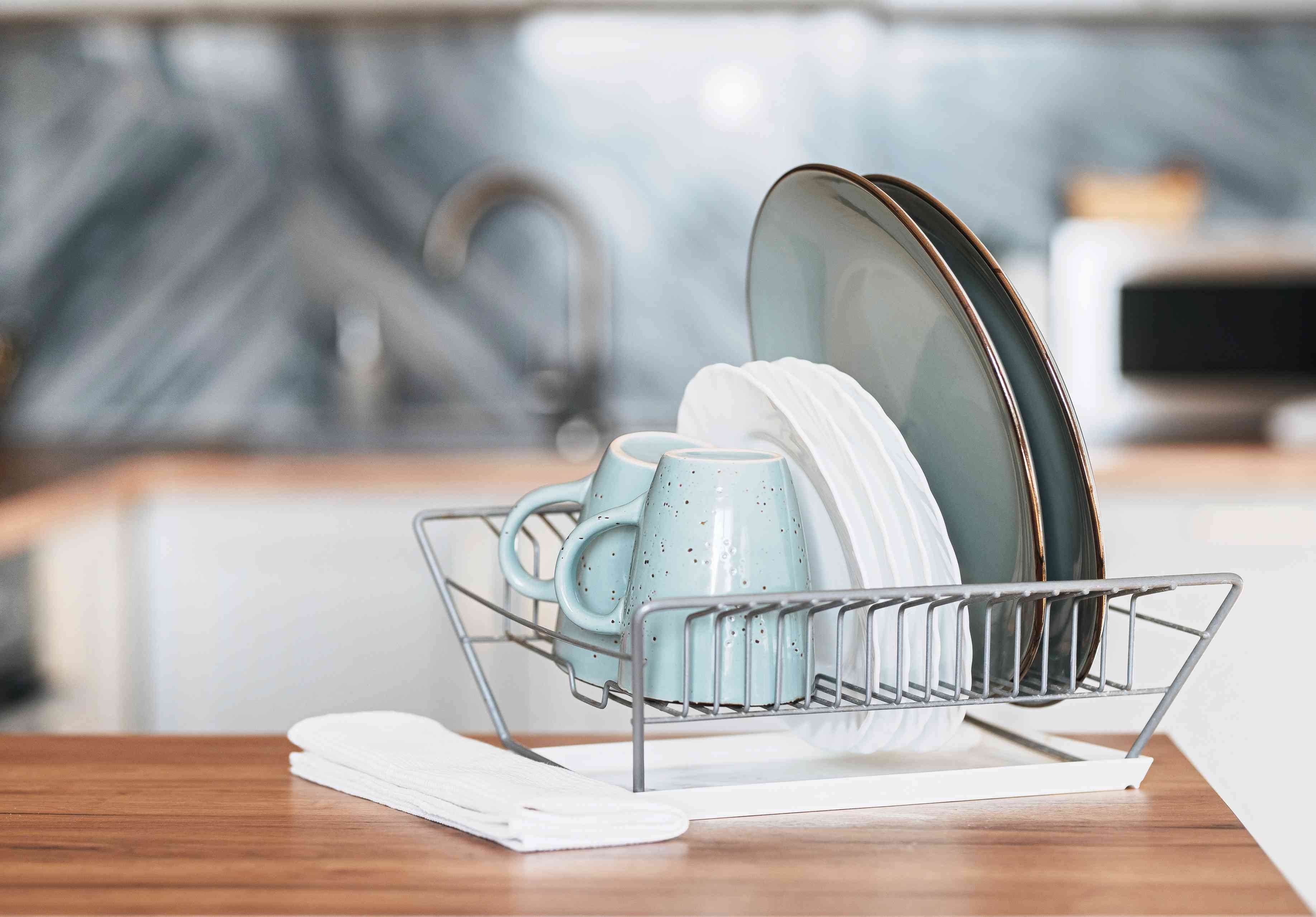 Clean dishes stacked in drying rack