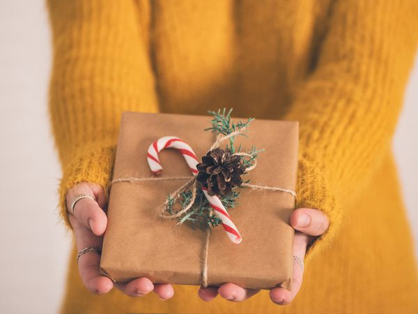 Close up of a woman holding gifts