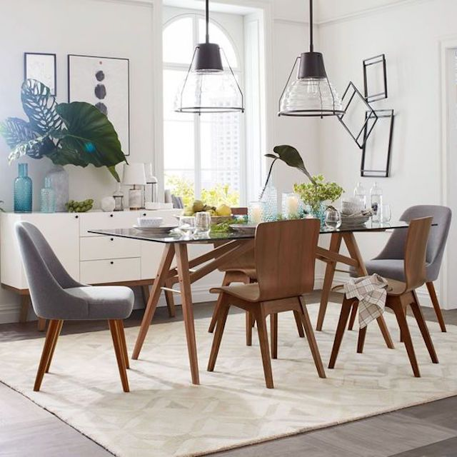 Dining Room With Geometric Rug And Wall Art