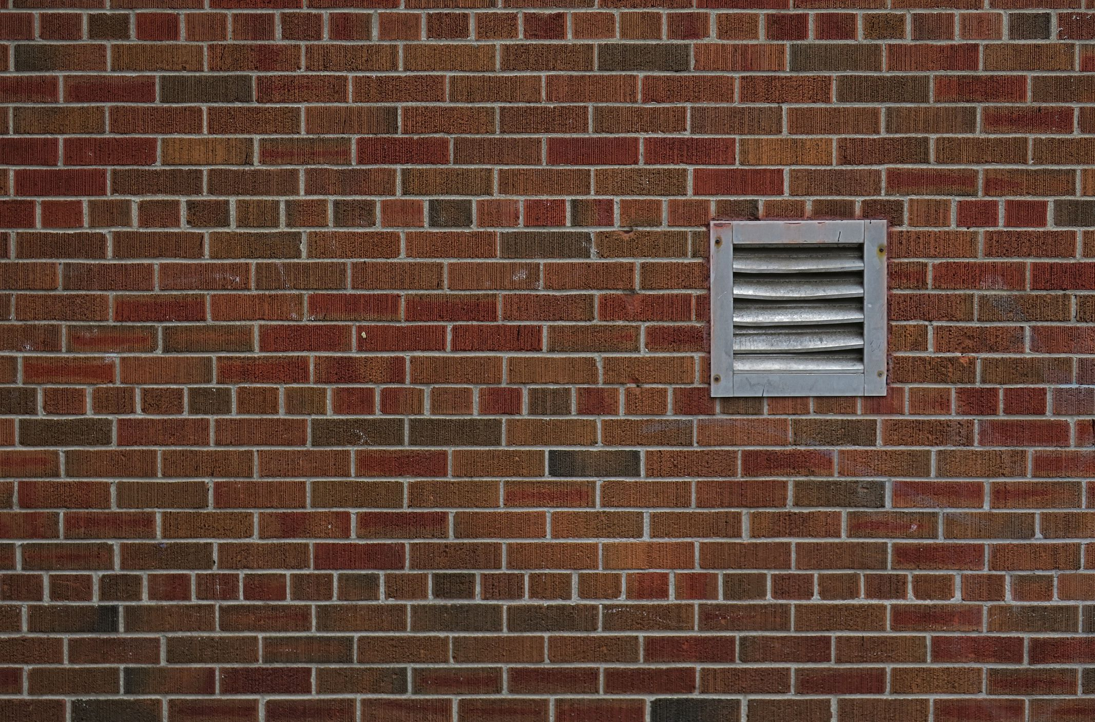 Ventilar en la pared de ladrillo