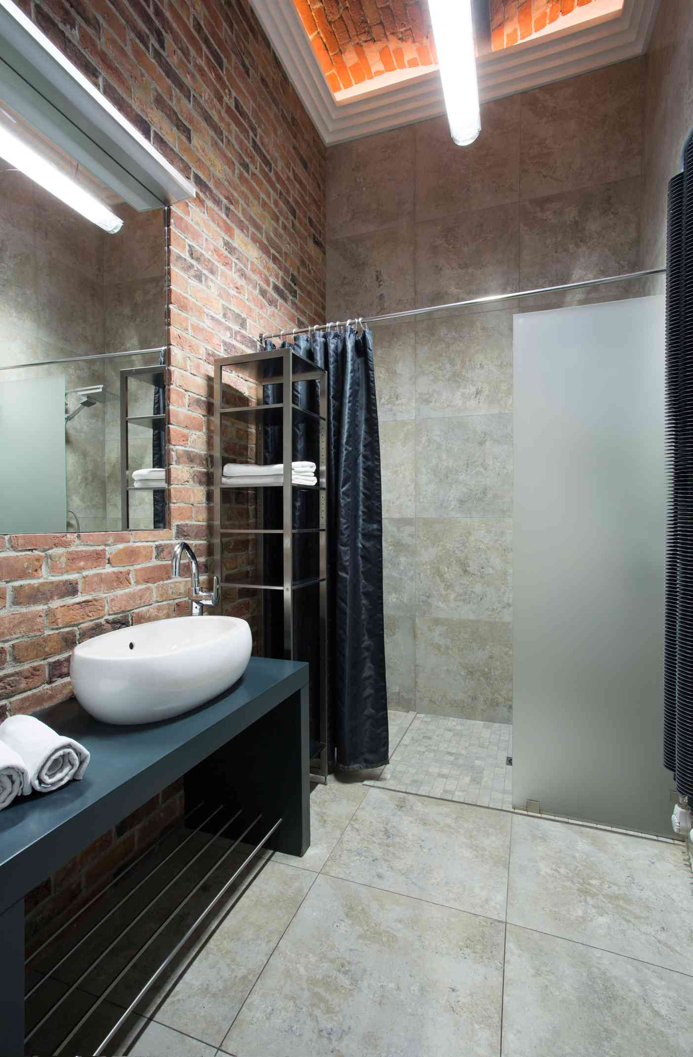 Industrial bathroom with brick
