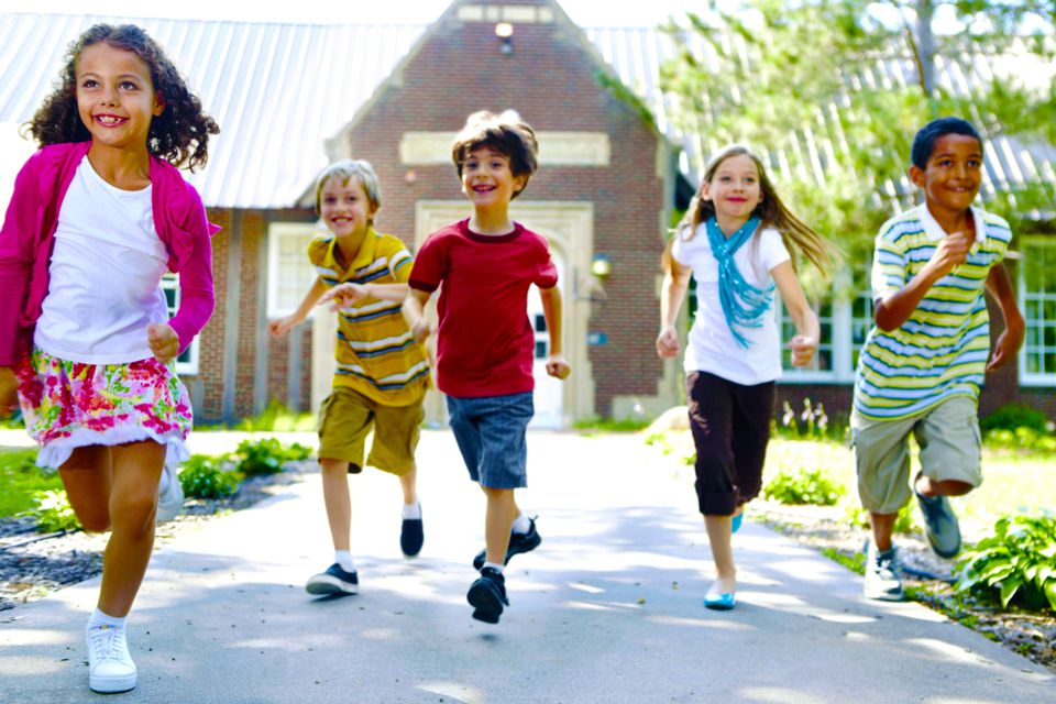 A group of kids running outside