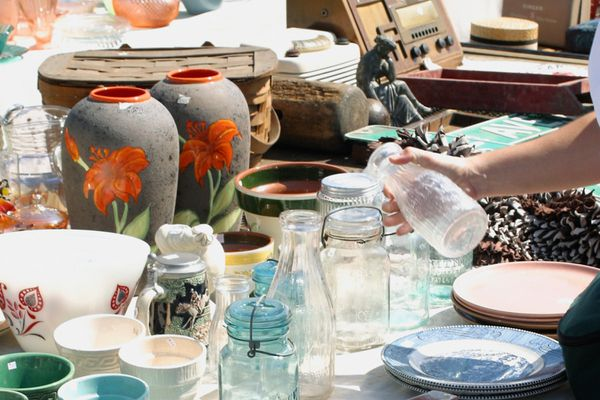 shopping at an outdoor flea market or yard sale