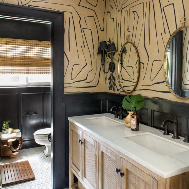 Black and neutral bathroom with double vanity.