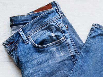 Raw denim jeans folded closeup