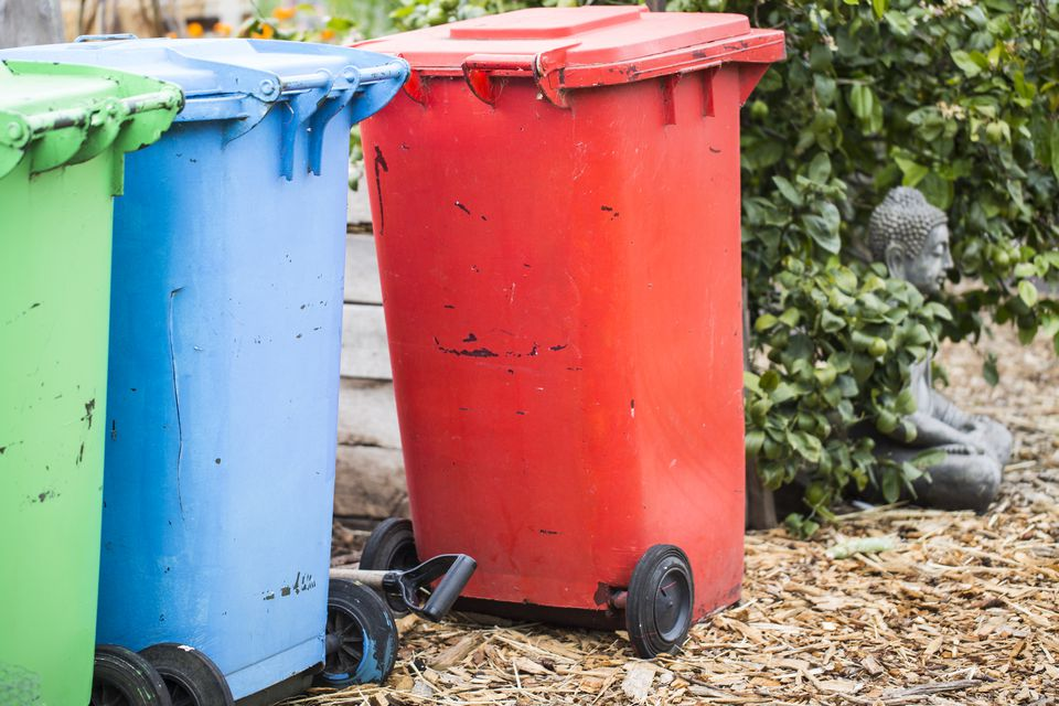Brightly painted trash bins