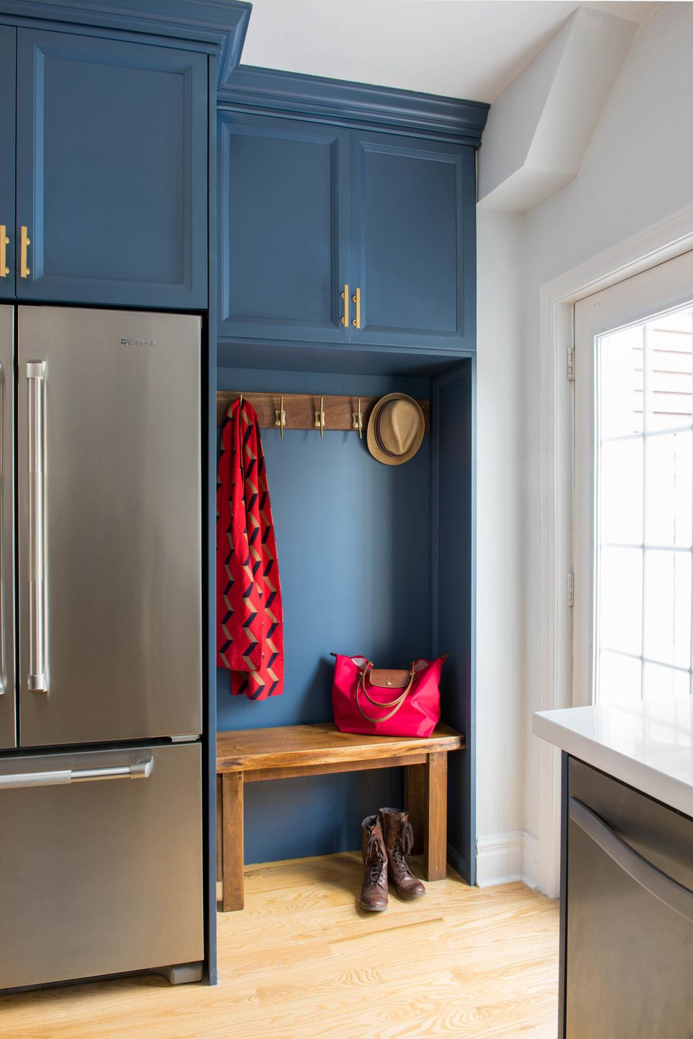 tiny wood bench mudroom in kitchen