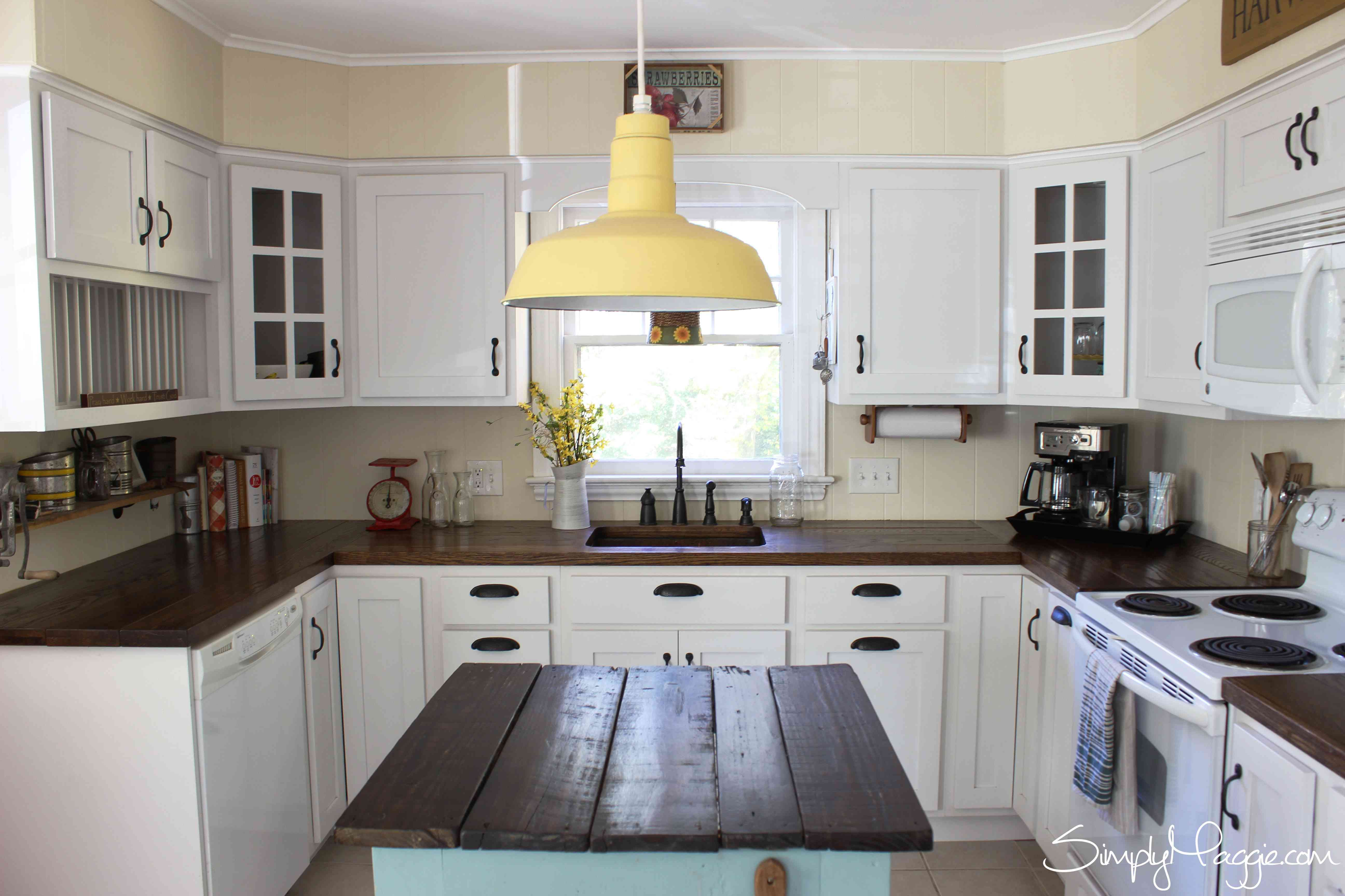 A kitchen with dark wood counters