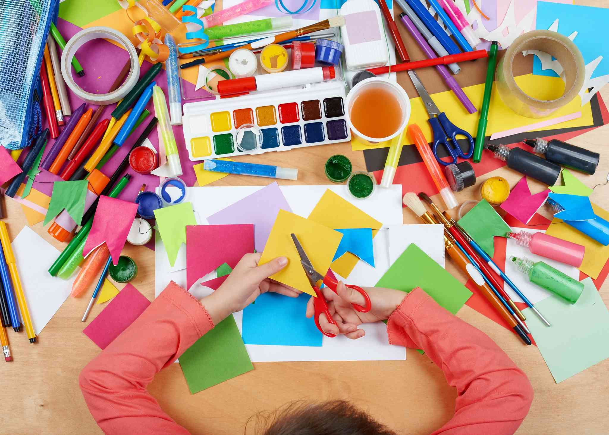 Child drawing top view. Artwork workplace with creative accessories.