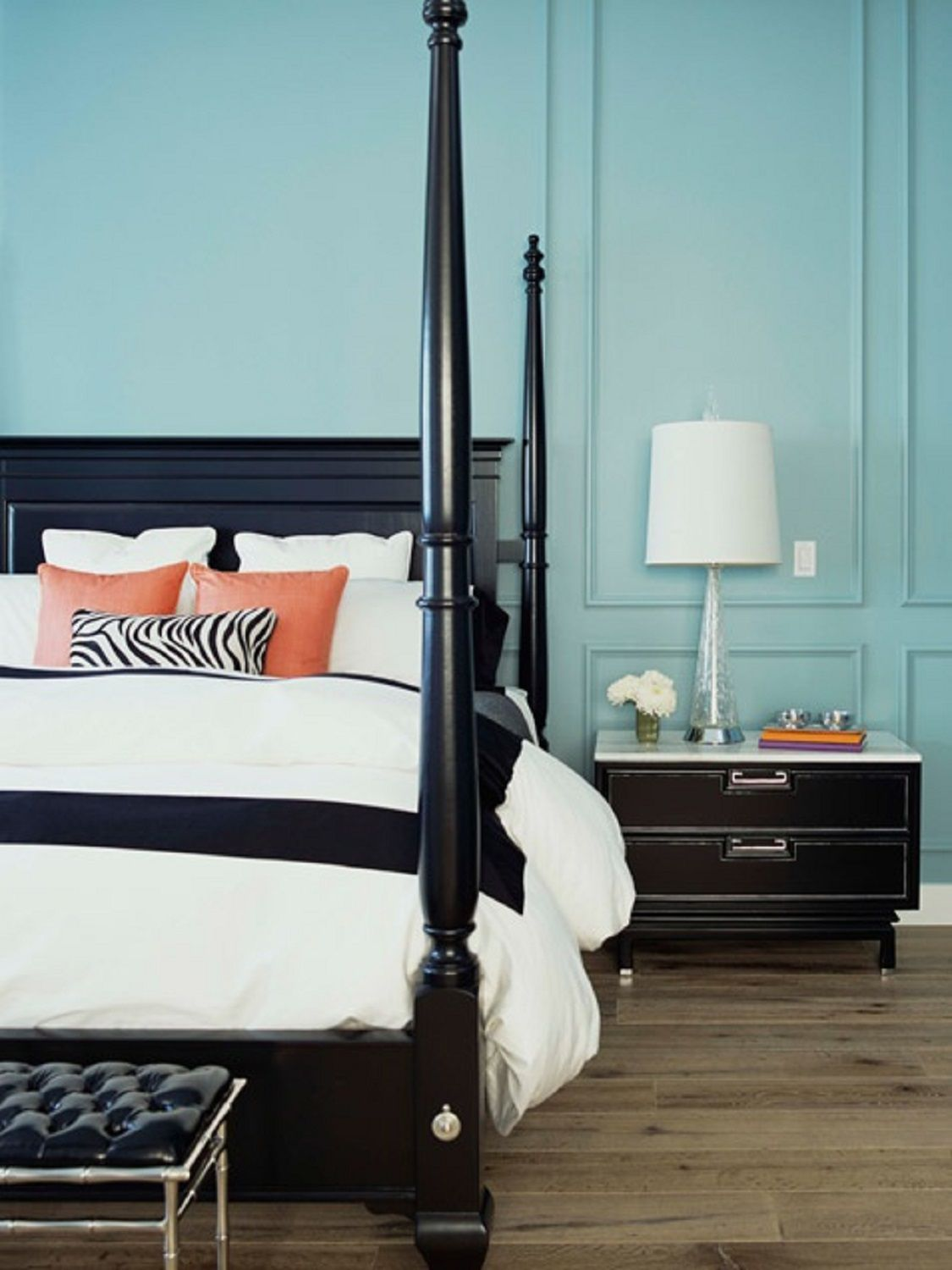 Bedroom with light turquoise walls.