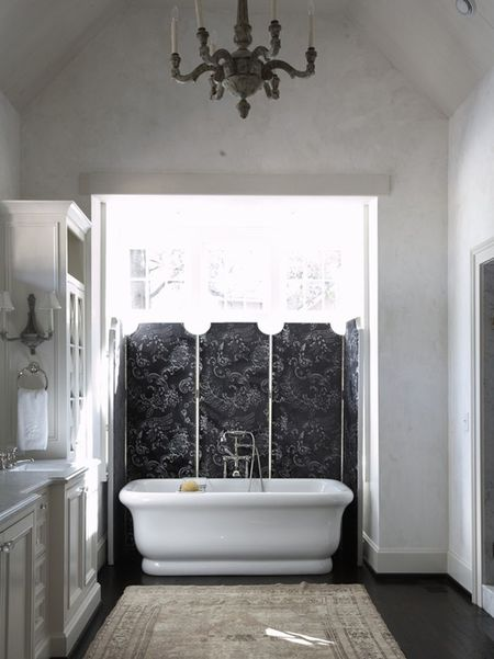 Luxurious Bathroom With Dark Wood Flooring