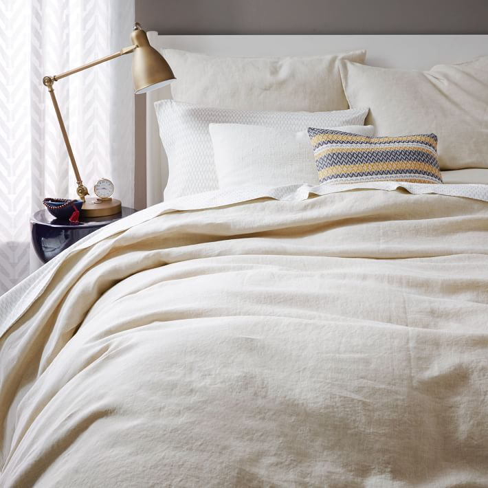 Beige bedspread with yellow and gray pillow